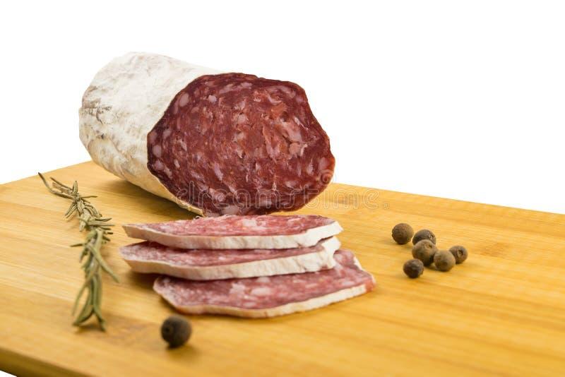 Smakelijke salami op een houten raad, de salami van Spanje royalty-vrije stock fotografie