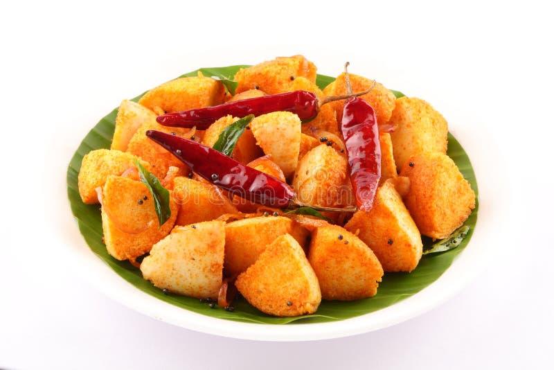 Smaklig frukost Chili Idly för bästa sikt på bananbladet arkivfoton