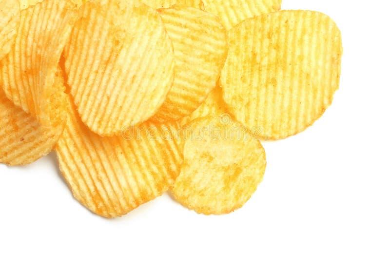 Smakliga ridged potatischiper royaltyfria bilder
