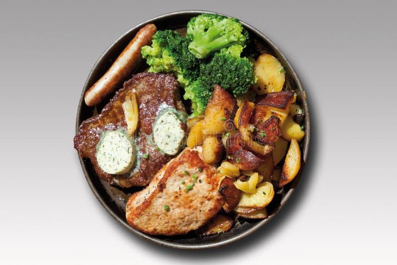 Smakosz niecka z piec mięsem, herbed masło, smażący p fotografia royalty free