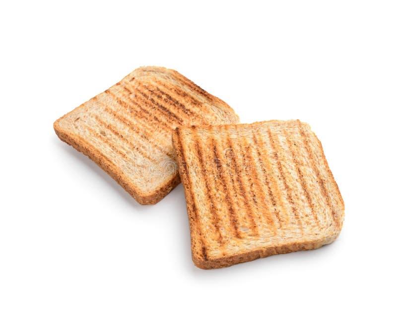 Smakowity wznosz?cy toast chleb na bia?ym tle zdjęcie royalty free