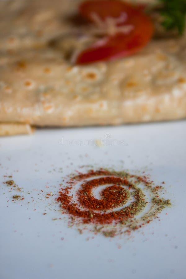 Smaktillsats för smaktillsats för smaktillsats för pulver för oreganon för röd peppar för mat royaltyfri fotografi