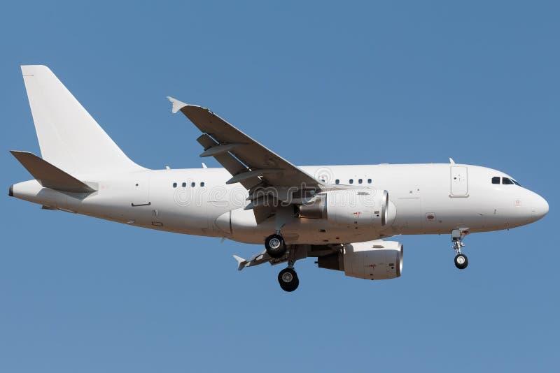 Smal kroppflygbuss för vit arkivfoton
