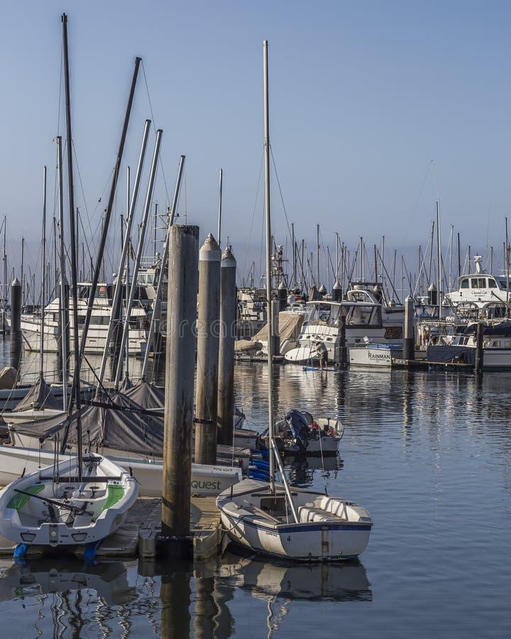 Smal and luxury boats water reflection at Santa Barbara, Marina, California stock photography