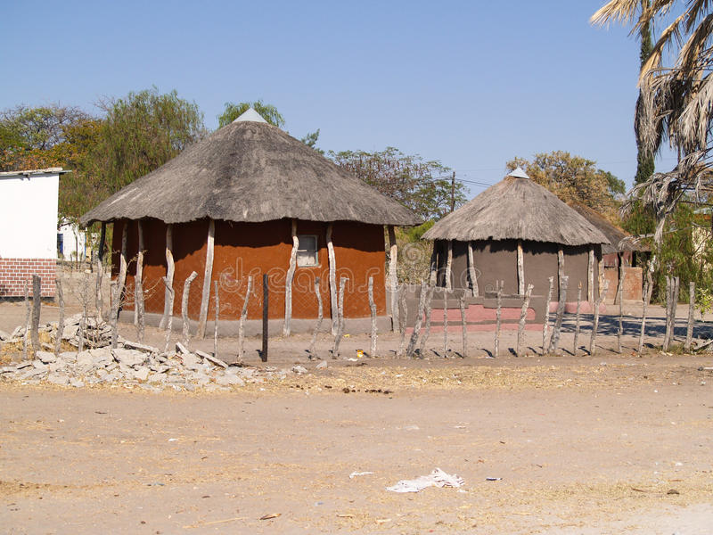 Small African village road, homes and people of Gweta Botswana stock image