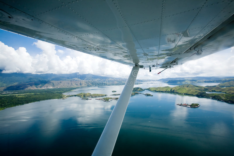 Small aircraft. Flying over lake Sentani, Papua Indonesia stock photography