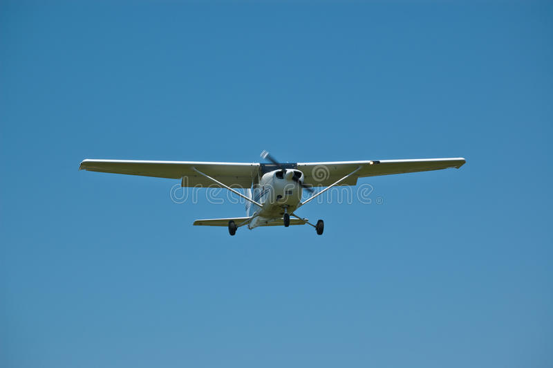 Small Aircraft in Flight with Blue Sky royalty free stock photography