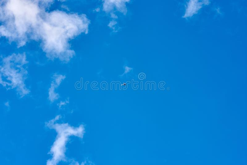 Small aircraft flying in a blue sky royalty free stock image