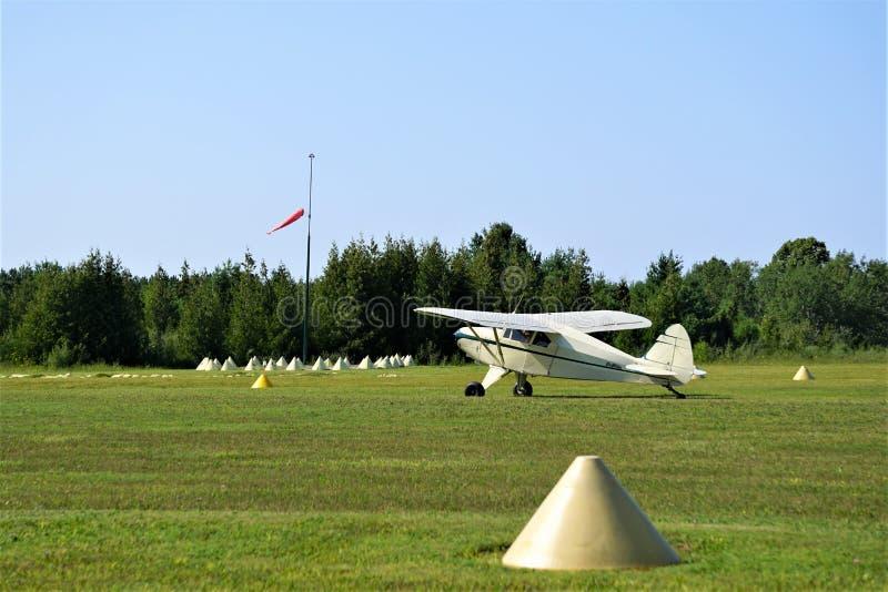 Single engine Cessna plane on grassy runway royalty free stock photos
