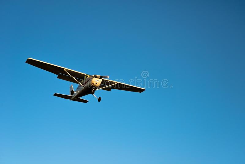 Small airplane approaching with blue sky. Small airplane approaching for landing with blue sky royalty free stock photos