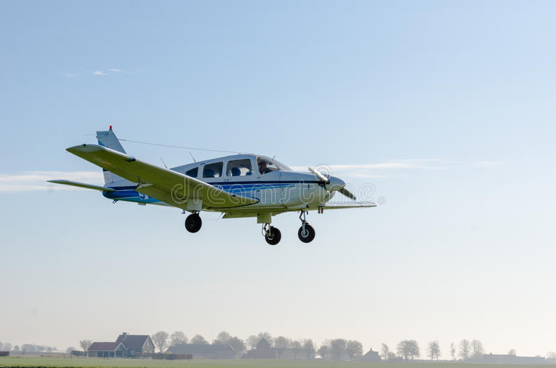 Small airplane flying stock photo
