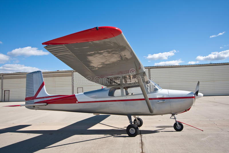 Download Small Airplane In Front Of Hangars Stock Photo - Image: 26406218