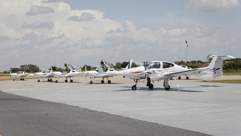Small airplane in front of hangars royalty free stock photo