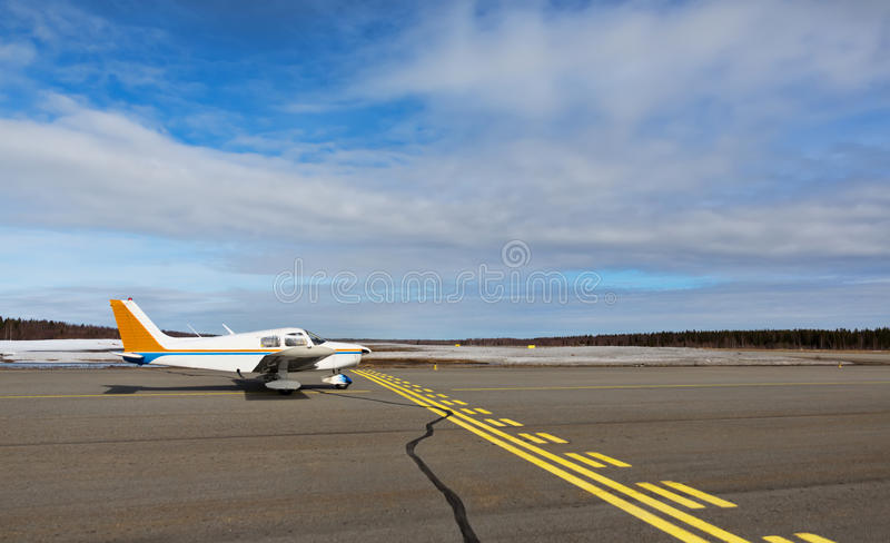 Small airplane in a small airport stock images