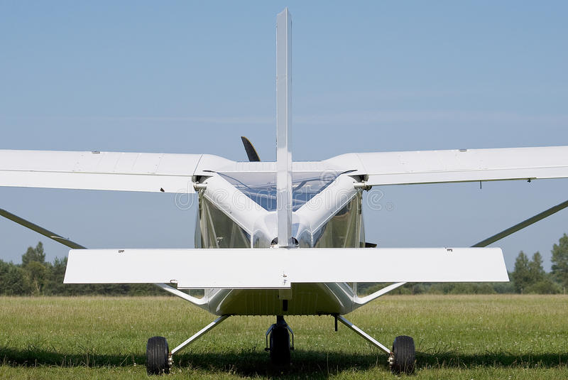 Small airplane. Small white airplane atnding on a grass runway stock photography