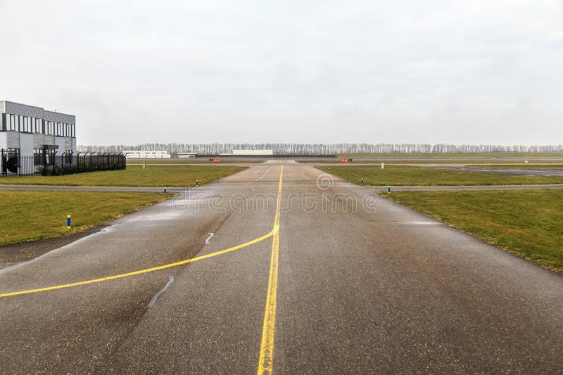 Small airport taxiway royalty free stock photography