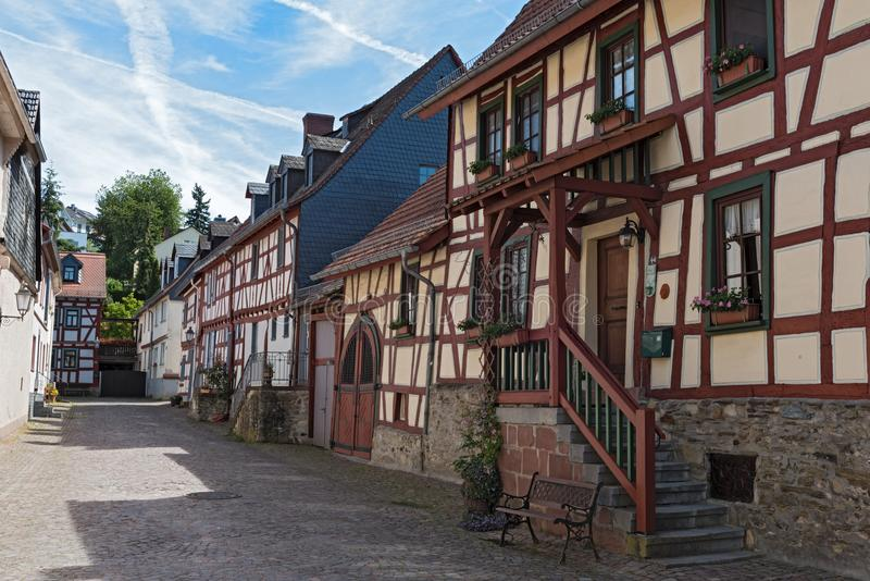 Small alley with half-timbered houses in the old town of Idstein, Hesse, Germany royalty free stock images