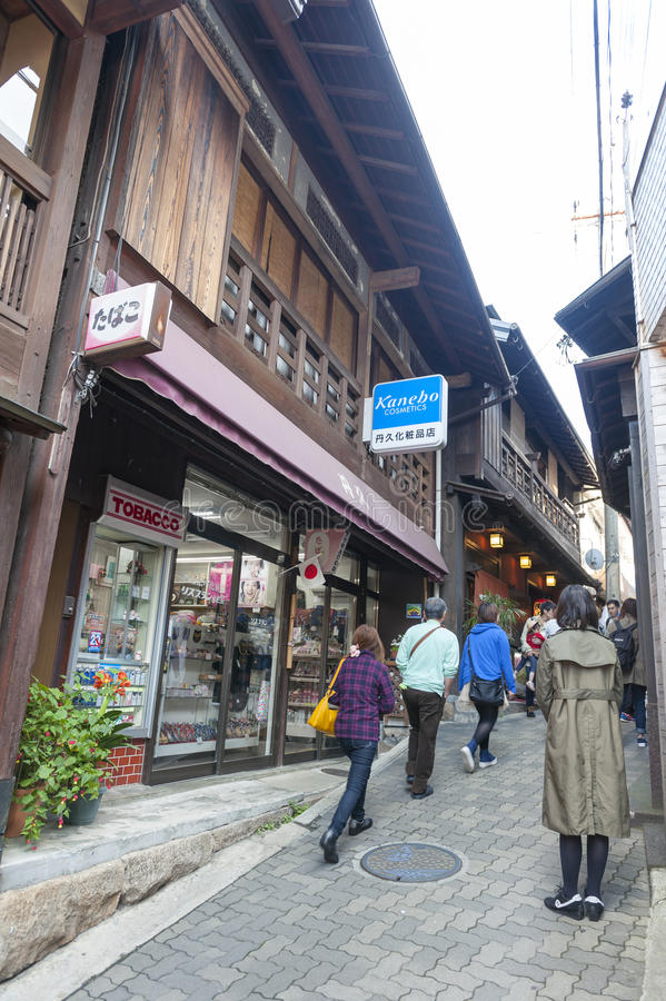 Small alley with souvenir shops and stores in the hot spring village of Arima Onsen in Kobe, Japan. Kobe, Japan - March 2016: Small alley with souvenir shops and royalty free stock images