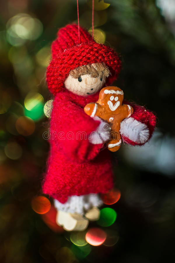 Small Alsatian character in the Christmas tree stock photo