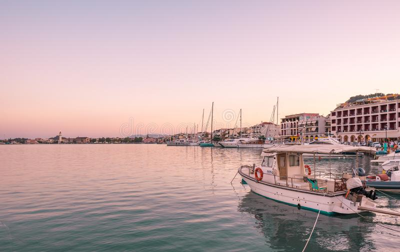 Small amateur fishing boats at pier with calm water ,Zakynthos, Greece - 08/03/2019 Sunny summer day at the Port of Zakynthos, Gre stock photos
