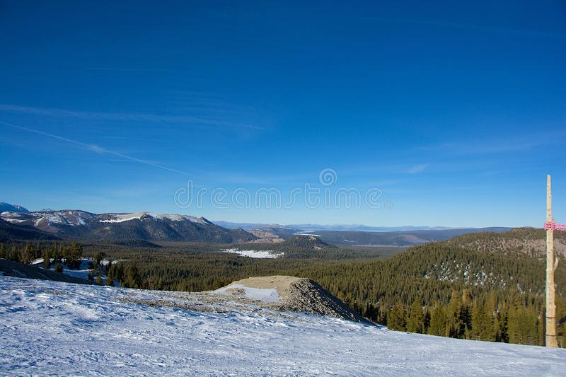 Small amount of Snow and Landscape of Mammoth Lakes. The small amount of snow had defrosted, so the mountains were not covered, leaving ramps and trails closed stock photo
