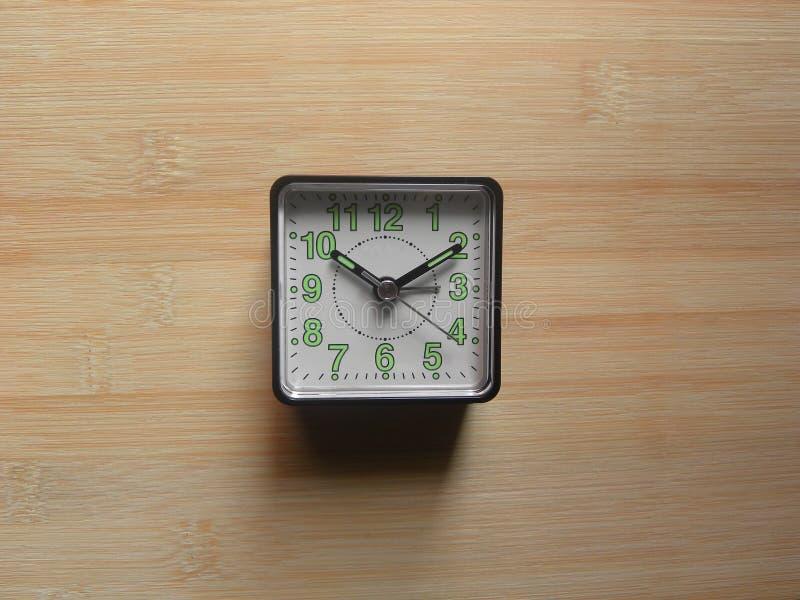 Small analog alarm clock royalty free stock photo