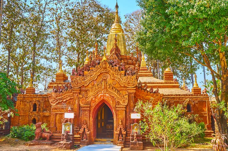 The small Ananda-style temple in Mahazedi Paya, Bago, Myanmar. The richly decorated carved small Ananda-style temple in garden of Mahazedi Pagoda, Bago, Myanmar royalty free stock photography