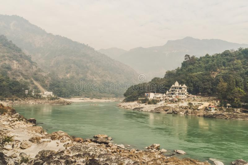 A small ancient Ashram on the Bank of the Ganges river in the Himalayas mountains. Sacred indian place - Rishikesh. A small ancient Ashram on the Bank of the stock photos
