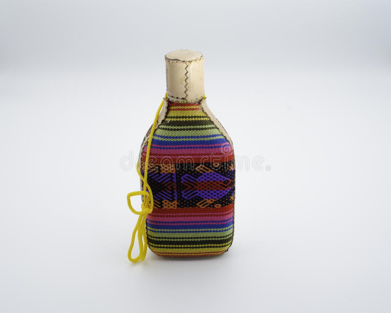 Small anisette bottle. Wrapped in wool fabric royalty free stock photography