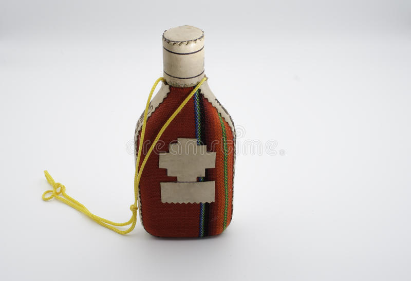 Small anisette bottle. Wrapped in wool fabric stock image