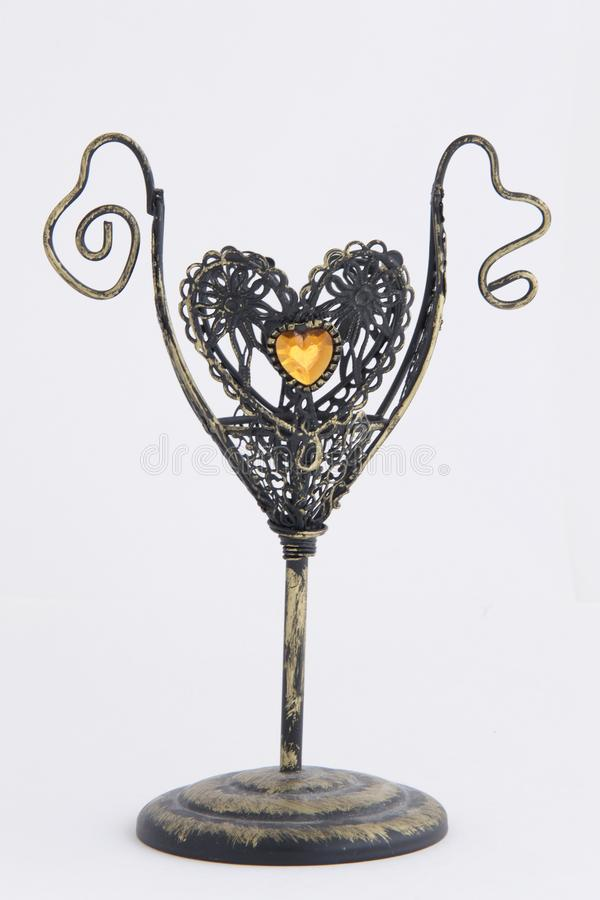 Small anitikvarny candlestick made of metal. With a decoration in the form of a heart, vintage, candle holder, decoration, retro stock image