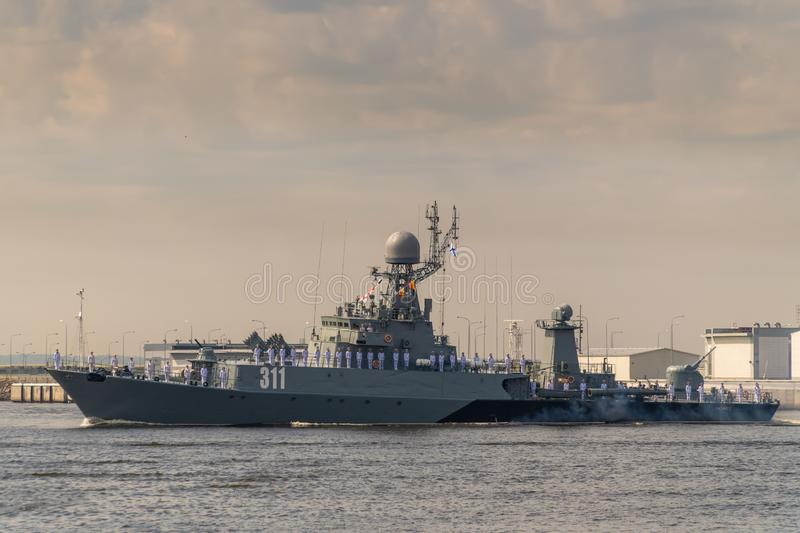 Small anti-submarine ship runs along Kronstadt during the celebration of the Day of The Navy. 28 July 2019. Russia. Kronshtadt. Small anti-submarine ship runs stock image