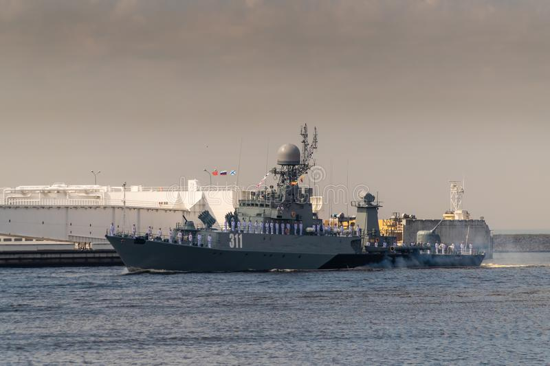 Small anti-submarine ship runs along Kronstadt during the celebration of the Day of The Navy. 28 July 2019. Russia. Kronshtadt. Small anti-submarine ship runs royalty free stock photography