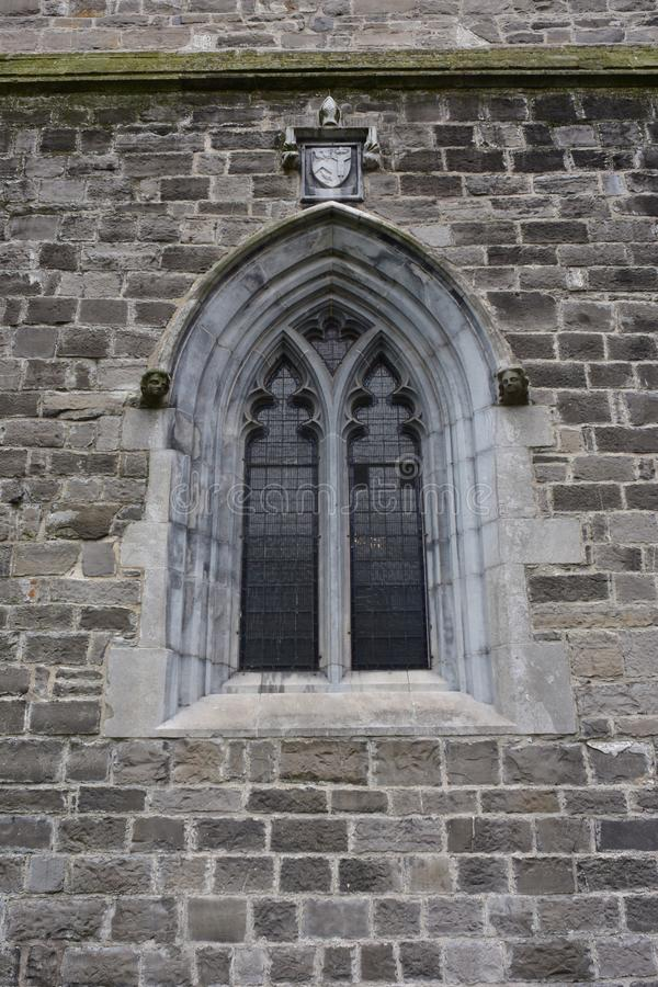 Free Small Arched Window On Stone Church Wall Stock Photography - 108214282