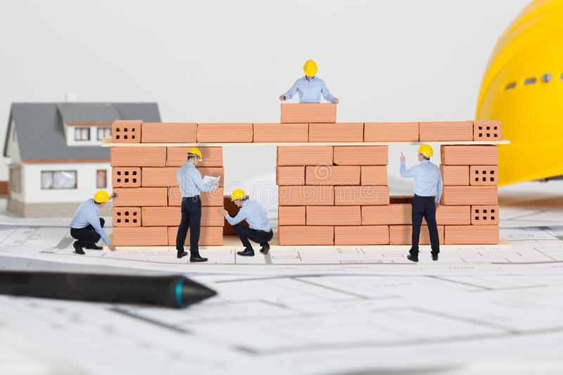 Small architects building model house construction stock photography