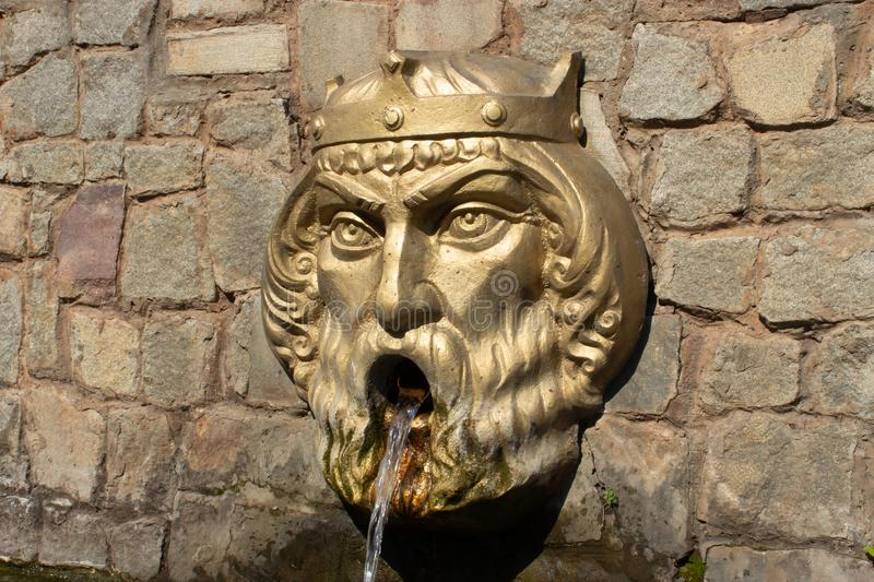 Small architectural form of the fountain head of the king royalty free stock photo