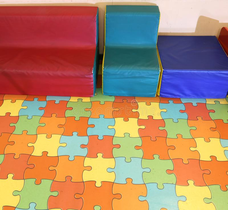 Small armchairs for children with a puzzle mat royalty free stock image
