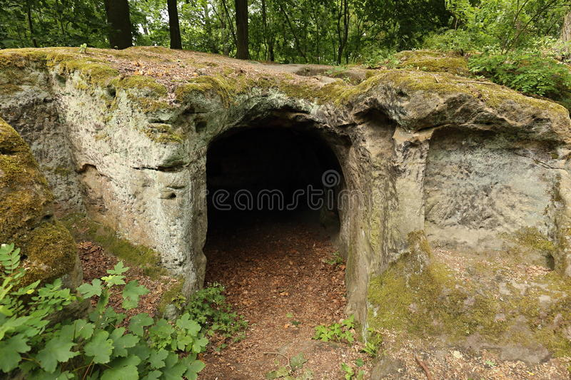 Small artificial cave cut into the sand stone rock royalty free stock photos