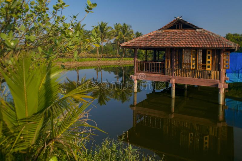 Small artificial lake in the beautiful Resort with wooden House for family activities Neral Maharashtra INDIA. 24 Nov 2005-Small artificial lake in the beautiful royalty free stock image