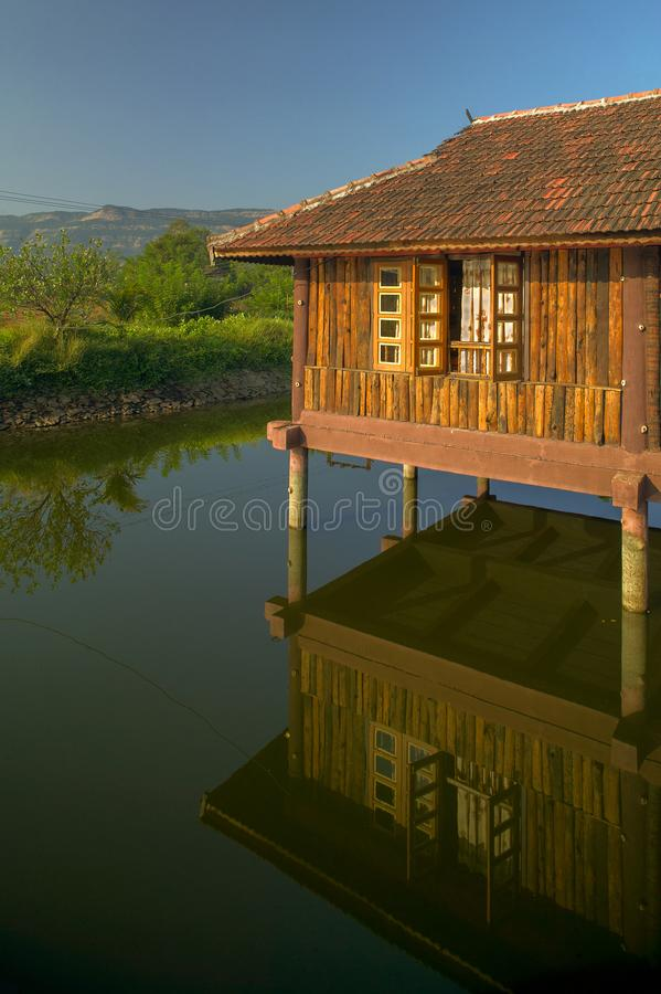 Small artificial lake in the beautiful Resort with wooden House for family activities Neral. 24 Nov 2005-Small artificial lake in the beautiful Resort with stock photos