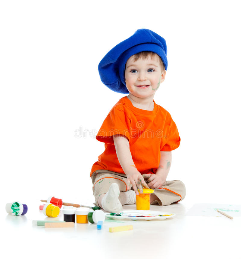 Small artist child with paints