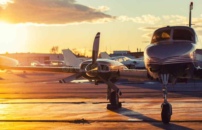 Small Aviation: Private Jet is Parked on a Tarmac in a Beautiful stock photo