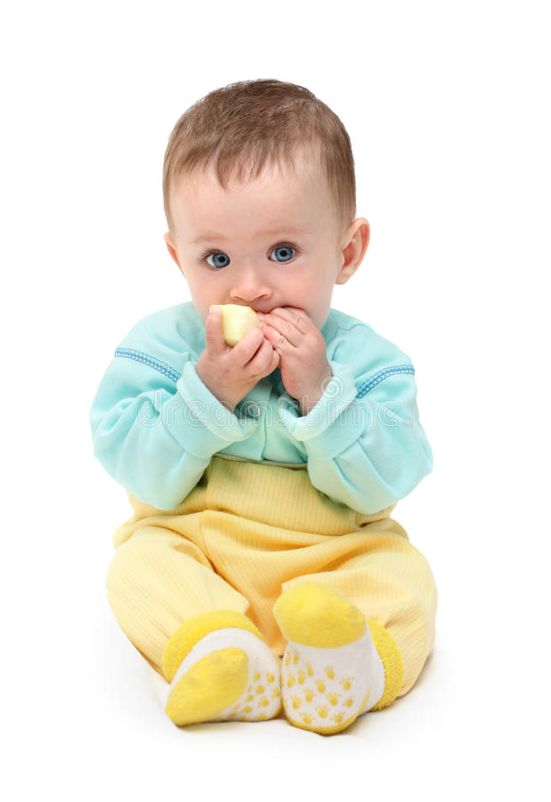 Small baby biting apple. Isolated on white royalty free stock photos