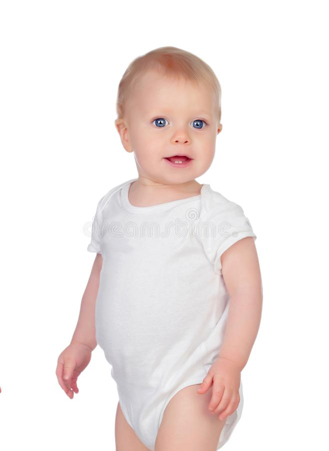 Small baby with a blue eyes and blond hair standing royalty free stock photography