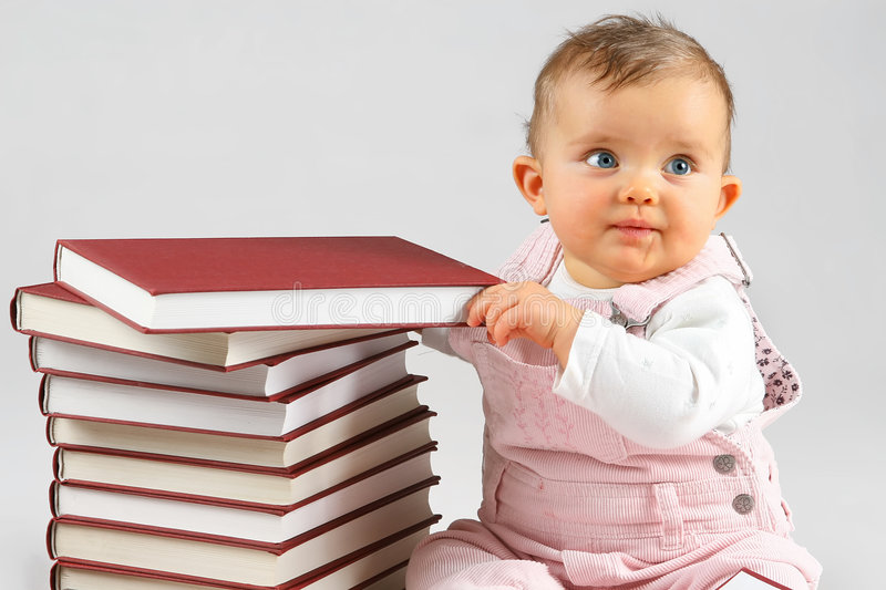 Small baby and books royalty free stock photo