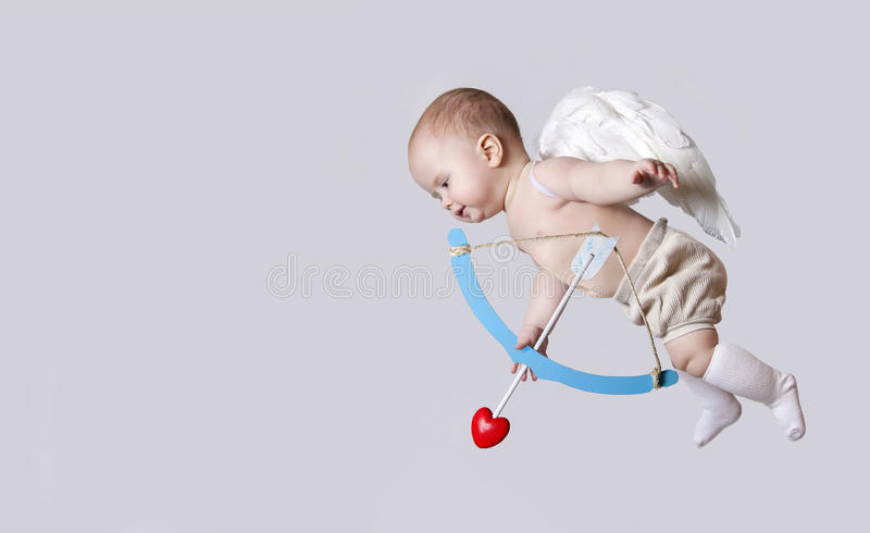 Small baby cupid with angel wings stock image