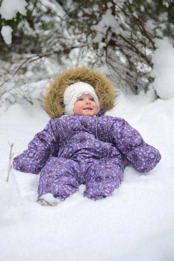 Small baby girl in the snow royalty free stock photography