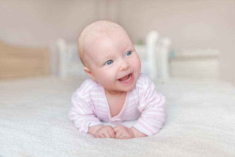 A small baby in a good mood. stock photos