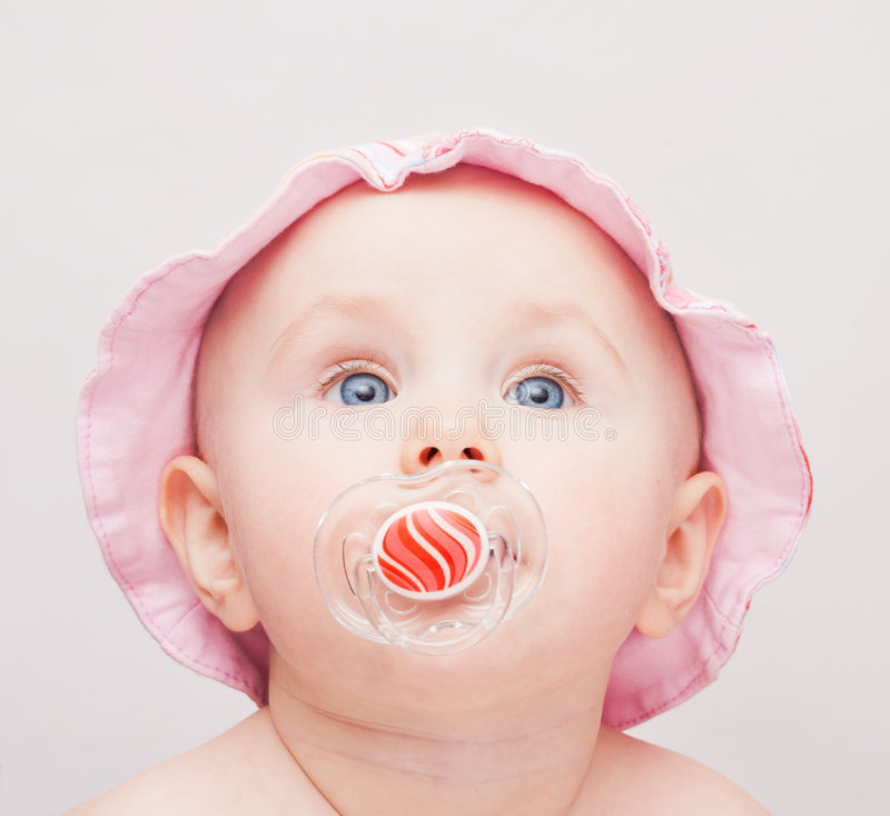 Small baby with pink hat. And dummy stock photo