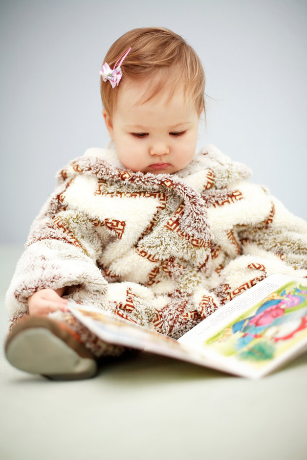 Download Small baby reading a book stock photo. Image of happy - 3784794